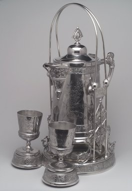 Pairpoint Manufacturing Company (1880-1929). Pitcher on Stand, ca. 1885. Silverplate, Pitcher: 13 x 10 15/16 x 7 3/4 in. (33 x 27.8 x 19.7 cm). Brooklyn Museum, Gift of Paul F. Walter, 1994.119.2a-c. Creative Commons-BY