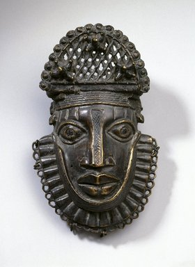 Edo. Hip Ornament with Human Face (Uhunmwun-ekue), 18th century (possibly). Copper alloy, iron, 6 1/2 x 4 1/8 x 2 1/4 in. (16.5 x 10.5 x 5.7 cm). Brooklyn Museum, Gift of Beatrice Riese, 1994.143. Creative Commons-BY