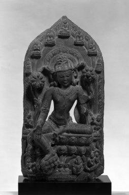 Stele with Seated Avalokitesvara, ca. 11th-12th Century. Dark gray stone, 19 3/4 x 9 7/8 in.  (50.2 x 25.1 cm). Brooklyn Museum, Gift of Mr. and Mrs. Paul E. Manheim, 1994.199.4. Creative Commons-BY