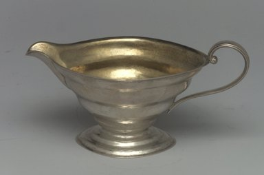 Reed & Barton (American, 1840-present). Creamer, Modernist Patter, Part of a 4-Piece Set, 1928-1929. Silver, 2 7/8 x 5 3/4 x 3 in. (7.3 x 14.6 x 7.6 cm). Brooklyn Museum, Gift of Daniel Morris and Denis Gallion, 1994.205.13. Creative Commons-BY