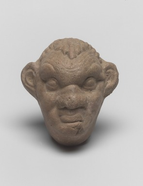 Molded Face of an Old Satyr, 2nd-1st century B.C.E. Terracotta, 3 1/4 x 2 7/8 x 1 5/8 in. (8.2 x 7.3 x 4.2 cm). Brooklyn Museum, Gift of Robin F. Beningson, 1994.209.3. Creative Commons-BY