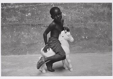 Martine Barrat (Algerian, born 1933). Paris, La Goutte D'or, Mamadou, 1982. Gelatin silver photograph, image: 12 1/4 x 18 in. (31.1 x 45.8 cm). Brooklyn Museum, Gift of the artist, 1994.6.1. © Martine Barrat