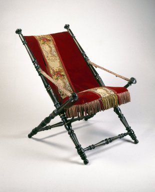 P.J. Hardy (American, 19th century). Folding Chair, Patented 1867. Ebonized wood, metal, original upholstery, 36 x 25 3/4 x 32 1/4 in.  (91.4 x 65.4 x 81.9 cm). Brooklyn Museum, Gift of Norman Mizuno and Alan J. Davidson, 1995.110. Creative Commons-BY