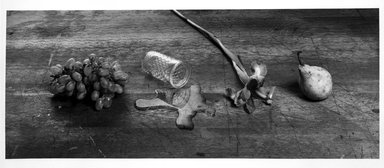 Zeke Berman (American, born 1951). Early Still Life with Spill, 1979. Gelatin silver photograph, image: 7 5/8 x 19 1/16 in. (19.4 x 48.4 cm). Brooklyn Museum, Gift of Eileen and Michael Cohen, 1995.204.2. © Zeke Berman