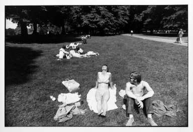 Brooklyn Museum: Untitled (Woman and Man Sunning Themselves in a Park), from Women are Beautiful Series