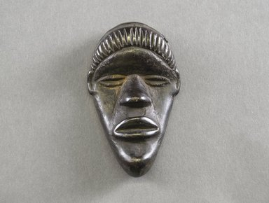 Dan. Personal Miniature Mask, 20th century. Wood, 3 3/4 x 2 3/8 x 1in. (9.5 x 6 x 2.5cm). Brooklyn Museum, Gift of Blake Robinson, 1995.7.23. Creative Commons-BY
