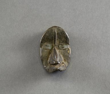Dan. Personal Miniature Mask, 20th century. Wood, metal, 3 x 1 3/4 x 1 5/8in. (7.6 x 4.4 x 4.1cm). Brooklyn Museum, Gift of Blake Robinson, 1995.7.25. Creative Commons-BY