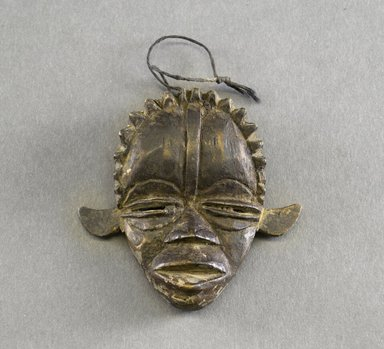 Dan. Personal Miniature Mask, 20th century. Wood, string, 3 x 3 1/8in. (7.6 x 7.9cm). Brooklyn Museum, Gift of Blake Robinson, 1995.7.3. Creative Commons-BY