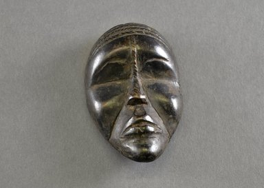 Mano. Personal Miniature Mask, 20th century. Wood, 4 1/8 x 2 1/2 x 1in. (10.5 x 6.4 x 2.5cm). Brooklyn Museum, Gift of Blake Robinson, 1995.7.43. Creative Commons-BY
