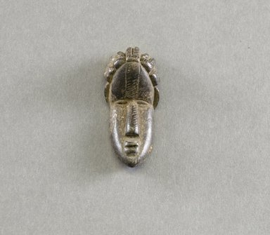 Bassa. Personal Miniature Mask, 20th century. Wood, 2 5/8 x 1 1/8 x 7/8 in. (6.7 x 2.9 x 2.2 cm). Brooklyn Museum, Gift of Blake Robinson, 1995.7.56. Creative Commons-BY