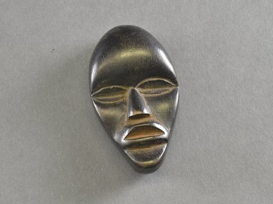 Mano. Personal Miniature Mask, 20th century. Wood, 3 1/2 x 2 x 7/8in. (8.9 x 5.1 x 2.2cm). Brooklyn Museum, Gift of Blake Robinson, 1995.7.71. Creative Commons-BY