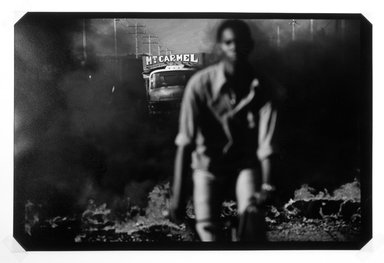 Alex Webb (American, born 1951). Port au Prince, Haiti, 1987, Burning Barricades, 1987. Cibachrome on Ilfochrome Classic paper Brooklyn Museum, Purchased with funds given by the Horace W. Goldsmith Foundation, Ardian Gill, the Coler Foundation, Harry Kahn, and Mrs. Carl L. Selden, 1995.75.1. © Alex Webb