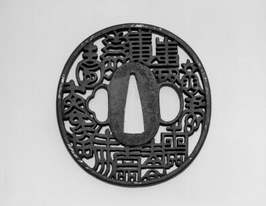 "Tsuba (Sword Guard) with ""Nunome"" Design, late 18th century. Iron with gold nunome (""cloth-pattern"" inlay), height: 2 3/4 in. Brooklyn Museum, Gift of the J. Aron Charitable Foundation, Inc. in memory of Jack R. Aron, 1995.9.3. Creative Commons-BY"