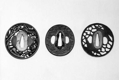 Sword Guard (Tsuba), late 16th-early 17th century. Engraved brass; copper sekigane, 2 5/8 x 2 3/8 in.  (6.7 x 6.0 cm). Brooklyn Museum, Gift of Dr. and Mrs. Barry Brumberg, 1999.98.4. Creative Commons-BY