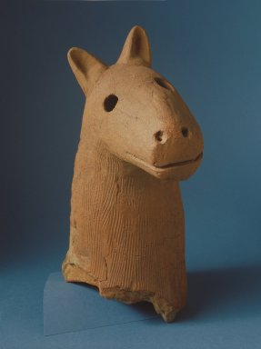 Haniwa Head of a Dog, 5th-6th centuries. Buff-red earthenware, 16 3/8 x 15 1/4 x 9 3/8 in. (including stand). Brooklyn Museum, Gift of Mrs. Carl L. Selden, 1996.123.1. Creative Commons-BY