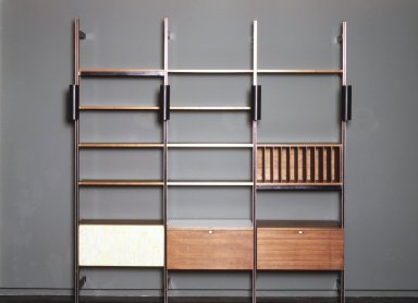 George Nelson (American, 1908-1986). Comprehensive Storage Unit (Storage and Shelving System), 1966-1968. Walnut, metal, fabric, glass, white laminate, 102 x 97 x 18 1/2 in. (264.4 x 264.2 x 47.0 cm). Brooklyn Museum, Gift of Myrna Greenberg Ladin and Leonard I. Ladin, 1996.182.1. Creative Commons-BY