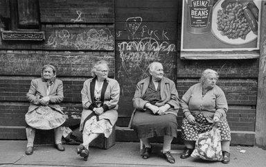 Vivian Cherry (American, born 1920). Lower East Side N.Y.C (Heinz Beans, Swastika on Wall Beyond Four Seated Women), ca 1950s. Gelatin silver photograph (vintage), image: 8 1/2 x 13 1/2 in. (21.6 x 34.3 cm). Brooklyn Museum, Gift of Steven Schmidt, 1996.241.9. © Vivian Cherry