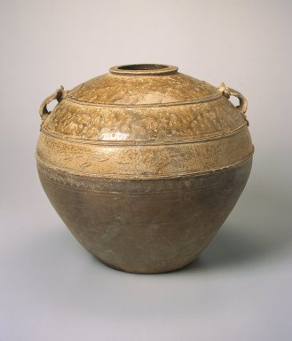 Storage Jar, 206 B.C.E.-220 C.E. Proto-Yue ware, stoneware with natural ash glaze, 13 1/4 x 15 3/8 in. (33.7 x 39.1 cm). Brooklyn Museum, Gift of Dr. and Mrs. George J. Fan, 1996.26.1. Creative Commons-BY