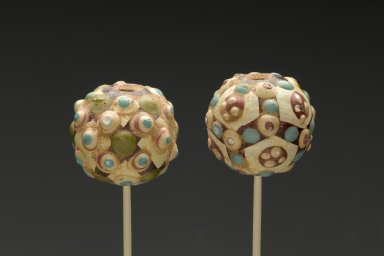 Bead, 5th-4th century B.C.E. Earthenware with polychrome decoration, 1 1/4 x 1 1/4in. (3.2 x 3.2cm). Brooklyn Museum, Gift of Giselle Croes, 1996.70.1. Creative Commons-BY