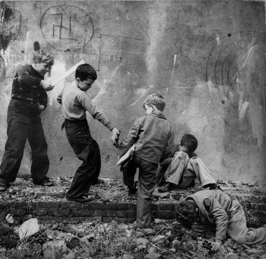 Vivian Cherry (American, born 1920). [Untitled] (Group of Boys and Swastika), 1948. Gelatin silver photograph (vintage), 7 1/2 x 7 1/2 in. (19.1 x 19.1 cm). Brooklyn Museum, Gift of Steven Schmidt, 1997.138.4. © Vivian Cherry