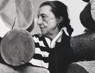 Arthur Mones (American, 1919-1998). Louise Bourgeois (Sculpture), 1988. Gelatin silver photograph on fiber based paper, sheet: 10 3/4 x 14 in. (27.2 x 35.6 cm). Brooklyn Museum, Gift of the artist, 1997.162.11. © Estate of Arthur Mones
