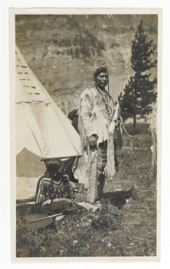 American. [Untitled] (Chief Standing in front of Teepee with Seated Woman), ca. 1900. Gelatin silver photograph, 5 1/4 x 3 1/8 in. (13.3 x 8.0 cm). Brooklyn Museum, Gift of Sasha Nyary and Family, 1997.163.5