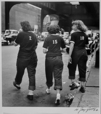 N. Jay Jaffee (American, 1921-1999). Three Girls Crossing Street (Livonia Avenue Under IRT New Lots El, East New York), from the series An Era Past: Photographs of Brownsville and East New York, Brooklyn, 1950; printed 1995. Selenium-toned gelatin silver photograph on Ilford Galerie FB paper, sheet: 8 x 10 in. (20.3 x 25.4 cm). Brooklyn Museum, Gift of Paula W. Hackeling, 1997.164.16. © The N. Jay Jaffee Trust