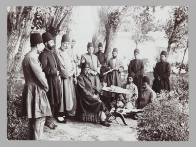 Mozaffar al-Din Shah and Attendants Seated in a Garden,  One of 274 Vintage Photographs, late 19th-early 20th century. Gelatin silver printing out paper, 4 5/8 x 6 1/4 in.  (11.7 x 15.9 cm). Brooklyn Museum, Purchase gift of Leona Soudavar in memory of Ahmad Soudavar, 1997.3.105