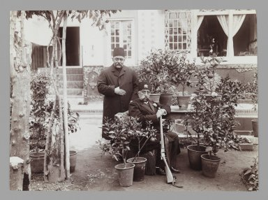 Mozaffar al-Din Shah with Amin al-Soltan in Garden, One of 274 Vintage Photographs, late 19th-early 20th century. Gelatin silver printing out paper, 4 5/8 x 6 5/16 in.  (11.7 x 16.0 cm). Brooklyn Museum, Purchase gift of Leona Soudavar in memory of Ahmad Soudavar, 1997.3.109