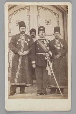 Mohammad 'Ali Shah with Mirza Mohammad Ebrahim Khan, the Moavin al-Dowleh, and Company, One of 274 Vintage Photographs, before 1907. Albumen silver photograph, Photo:  8 3/8 x 6 1/4 in.  (21.3 x 15.9 cm);. Brooklyn Museum, Purchase gift of Leona Soudavar in memory of Ahmad Soudavar, 1997.3.121