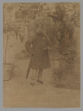 Mozaffar al-Din Shah Standing in a Garden, One of 274 Vintage Photographs, late 19th-early 20th century. Albumen silver photograph, 5 1/2 x 4 1/16 in.  (13.9 x 10.3 cm). Brooklyn Museum, Purchase gift of Leona Soudavar in memory of Ahmad Soudavar, 1997.3.125