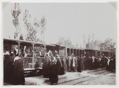 Antoin Sevruguin (probably). Veiled Women Boarding a Train, One of 274 Vintage Photographs, Late 19th century. Albumen silver photograph, 4 3/4 x 6 1/2 in.  (12.1 x 16.5 cm). Brooklyn Museum, Purchase gift of Leona Soudavar in memory of Ahmad Soudavar, 1997.3.12