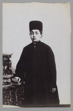 Young Prince with his Hand on a Book, One of 274 Vintage Photographs, late 19th-early 20th century. Albumen silver photograph, 8 1/2 x 5 1/2 in.  (21.6 x 14.0 cm). Brooklyn Museum, Purchase gift of Leona Soudavar in memory of Ahmad Soudavar, 1997.3.132