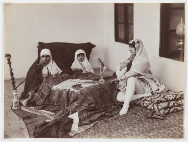 Antoin Sevruguin. Two Ladies and a Child Reposing in the Harem, Late 19th century. Albumen silver photograph, 6 3/16 x 8 3/16 in.  (15.7 x 20.8 cm). Brooklyn Museum, Purchase gift of Leona Soudavar in memory of Ahmad Soudavar, 1997.3.14