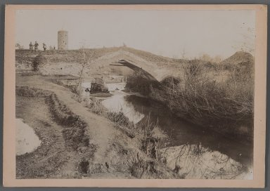 View of a River with Bridge-Tower of Patterned Brickwork, One of 274 Vintage Photographs, late 19th-early 20th century. Gelatin silver printing out paper, Photo:  6 7/16 x 9 1/16 in.  (16.4 x 23.0 cm);. Brooklyn Museum, Purchase gift of Leona Soudavar in memory of Ahmad Soudavar, 1997.3.168
