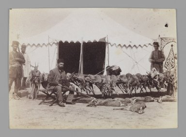 Prince Abdul Husayn Mirza (Farma Farmaian) Seated before Hunted Gazelles, One of 274 Vintage Photographs, late 19th-early 20th century. Albumen silver photograph, 4 3/4 x 6 5/8 in.  (12.1 x 16.9 cm). Brooklyn Museum, Purchase gift of Leona Soudavar in memory of Ahmad Soudavar, 1997.3.207