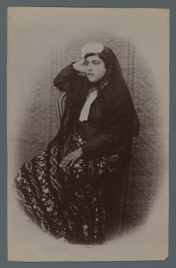 Studio Shot of Woman Seated Against a Woven Wicker Backdrop , One of 274 Vintage Photographs, late 19th-early 20th century. Albumen silver photograph, 8 3/16 x 5 3/16 in.  (20.8 x 13.2 cm). Brooklyn Museum, Purchase gift of Leona Soudavar in memory of Ahmad Soudavar, 1997.3.20