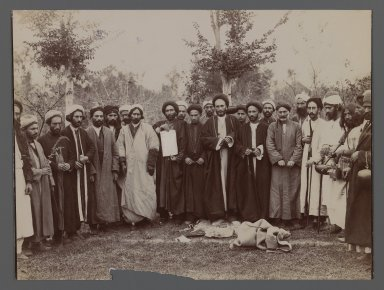 A Group of Religious Men in Religious Garb  holding up a Piece of Calligraphy, One of 274 Vintage Photographs, late 19th-early 20th century. Gelatin silver printing out paper, 6 7/16 x 9 7/16 in.  (16.4 x 23.9 cm). Brooklyn Museum, Purchase gift of Leona Soudavar in memory of Ahmad Soudavar, 1997.3.235