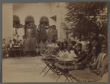 Persian Officials and  Attendants at a Party with Sweetmeats,  One of 274 Vintage Photographs, late 19th-early 20th century. Albumen silver photograph, 6 3/4 x 9 in.  (17.1 x 22.9 cm). Brooklyn Museum, Purchase gift of Leona Soudavar in memory of Ahmad Soudavar, 1997.3.239