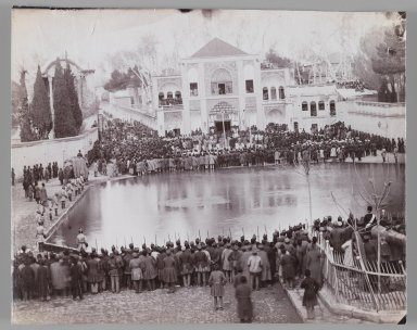 A Royal Ceremony in the Arg before the Naghar Kaneh(?),  One of 274 Vintage Photographs, late 19th-early 20th century. Albumen silver photograph, 6 13/16 x 8 7/16 in.  (17.3 x 21.5 cm). Brooklyn Museum, Purchase gift of Leona Soudavar in memory of Ahmad Soudavar, 1997.3.242