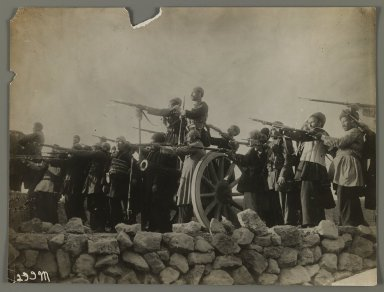 Theatrical Photograph of Soldiers Pointing Guns,  One of 274 Vintage Photographs, late 19th-early 20th century. Gelatin silver printing out paper, 7 5/16 x 9 5/8 in.  (18.5 x 24.5 cm). Brooklyn Museum, Purchase gift of Leona Soudavar in memory of Ahmad Soudavar, 1997.3.245