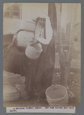Woman Carrying Baskets with Veil Thrown Aside, One of 274 Vintage Photographs, late 19th-early 20th century. Albumen silver photograph, 8 3/16 x 6 3/16 in.  (20.8 x 15.7 cm). Brooklyn Museum, Purchase gift of Leona Soudavar in memory of Ahmad Soudavar, 1997.3.28