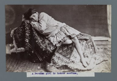 Young Girl Lying Down on Kilim, One of 274 Vintage Photographs, late 19th-early 20th century. Albumen silver photograph, 4 7/8 x 7 5/8 in.  (12.4 x 19.3 cm). Brooklyn Museum, Purchase gift of Leona Soudavar in memory of Ahmad Soudavar, 1997.3.29