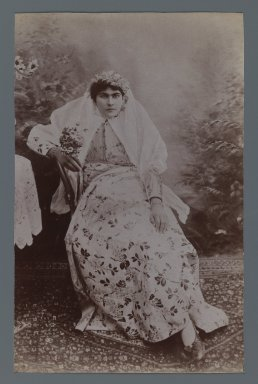 Seated Woman  Crowned with Garland, One of 274 Vintage Photographs, late 19th-early 20th century. Albumen silver photograph, 8 3/16 x 5 3/16 in.  (20.8 x 13.2 cm). Brooklyn Museum, Purchase gift of Leona Soudavar in memory of Ahmad Soudavar, 1997.3.31