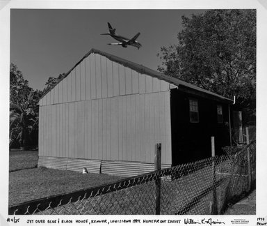 William Greiner. Jet Over Blue and Black House, Kenner, Louisiana, from the Homefront Series, 1994; printed 1997. Cibachrome print on Kodak professional paper, image: 18 1/8 x 21 7/8 in. (46.1 x 55.6 cm). Brooklyn Museum, Purchased with funds given by Ardian Gill, 1997.87.2. © William Greiner