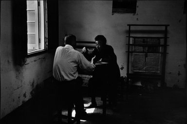 Larry Silver (American, born 1934). Two Men Playing a Game, Home for the Elderly, Yangzhou City, China, October 1996. Gelatin silver photograph, image: 12 3/4 x 18 1/2 in. (30.8 x 47.6 cm). Brooklyn Museum, Gift of Bruce Silverstein, 1997.99.1. © Larry Silver