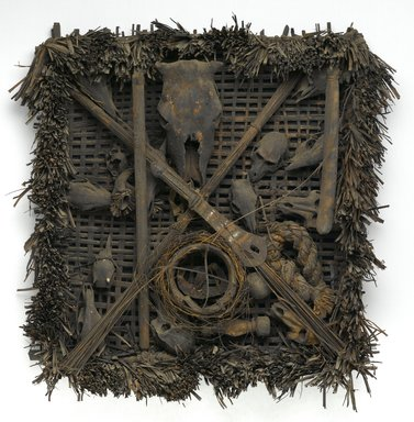 Ejagham. Emblem of the Leopard Spirit Society (Nkpa), 19th century. Wood, animal skulls, plant fiber, iron, pigment, 37 x 36 x 9 in.  (94.0 x 91.4 x 22.9 cm). Brooklyn Museum, Frank L. Babbott Fund, 1998.123. Creative Commons-BY