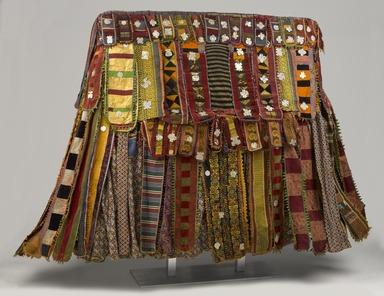 Yoruba. Egungun Dance Costume, mid 20th century. Wood, cotton and wool textiles, aluminum, est.: 55 x 6 x 63 in. (139.7 x 15.2 x 160 cm). Brooklyn Museum, Gift of Sam Hilu, 1998.125. Creative Commons-BY