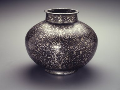 Container, Bidri-ware, 18th century. Copper alloy inlaid with silver decoration, 8 1/2 x 10 in., 11 lb. (21.6 x 25.4 cm, 4.99kg). Brooklyn Museum, Gift of Georgia and Michael de Havenon, 1998.132. Creative Commons-BY