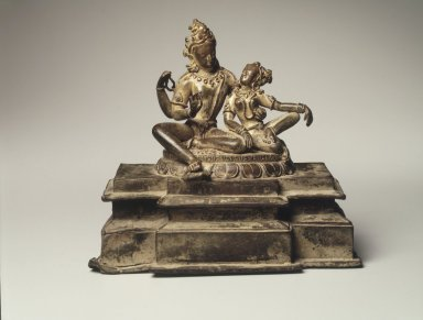 Uma-Maheshvara (Shiva and His Consort Parvati), 13th century. Bronze with traces of gilding and inlaid rubies, 6 1/2 x 7 x 3 1/2 in.  (16.5 x 17.8 x 8.9 cm). Brooklyn Museum, Gift of Amy and Robert L. Poster in memory of Mahmood T. Diba, 1998.133. Creative Commons-BY